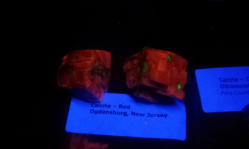 Shortwave Photo Sample two Calcite rhombs glowing bright red