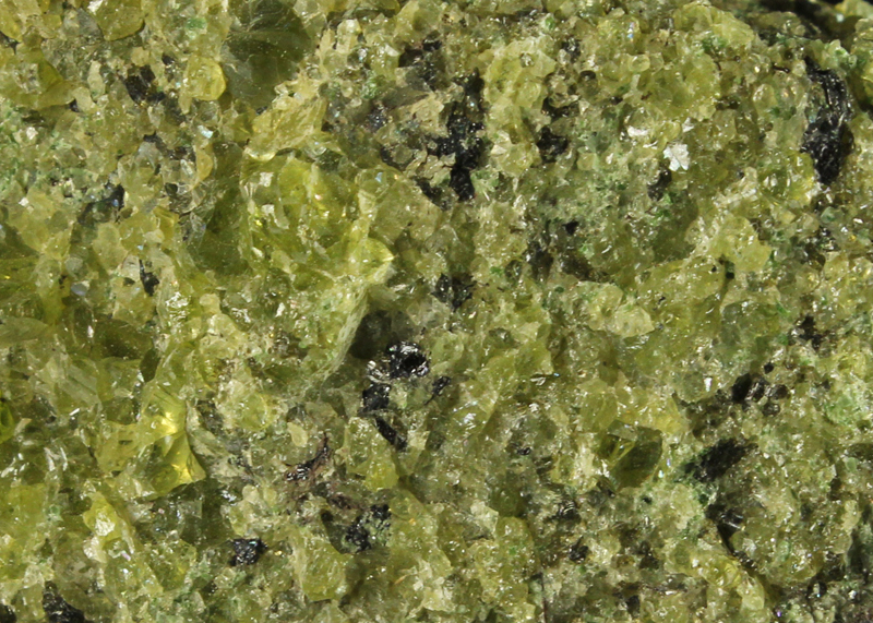 Close up view of Peridot Grains in a Basalt Volcanic Matrix