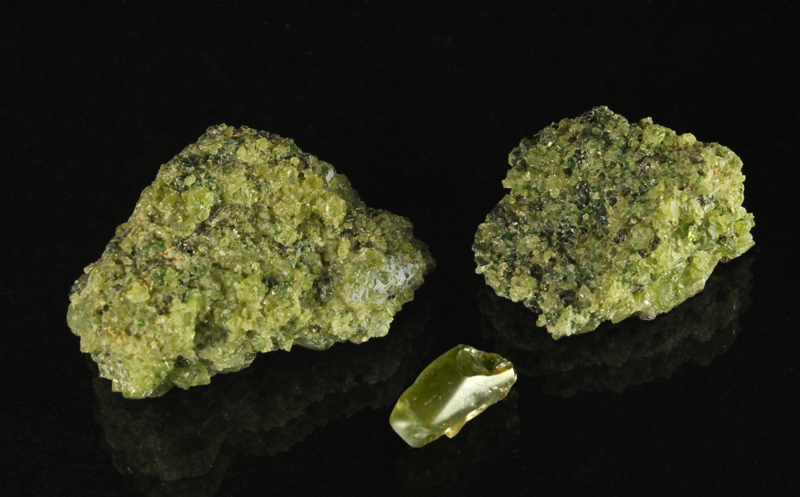 Two Peridot Lava Bomb Samples and one large grain, ready to be faceted
