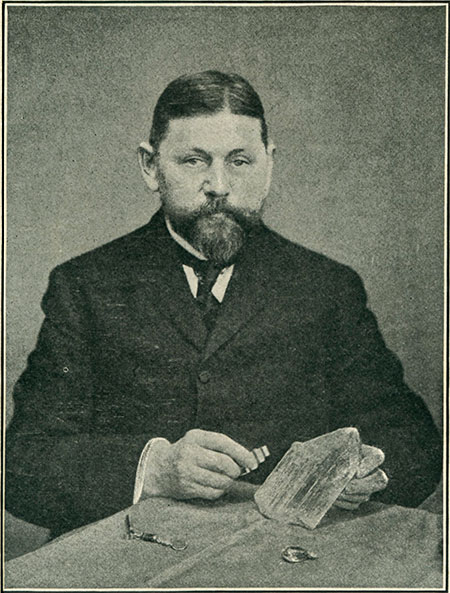George Kunz examining crystals of spodumene var. Kunzite around 1905.