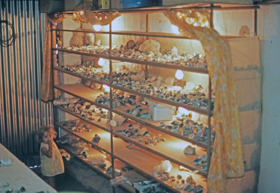 Display of minerals (including many fine dioptase specimens) for sale in Tsumeb miner's Robbie Groebler's home in 1974, most of which could be had for under $10 (photo © Rock Currier/Mindat.org)