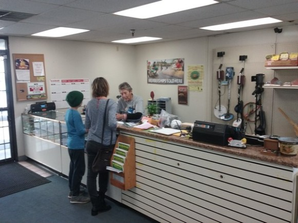 Cyndy talking to two customers looking forward to signing up for some lapidary classes