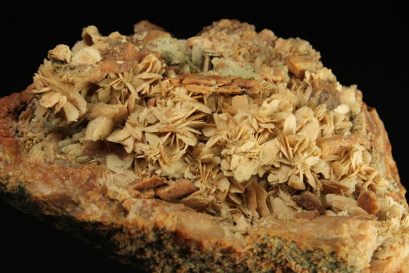 Thin blades of Calcite forming on the inside of a red jasper geode