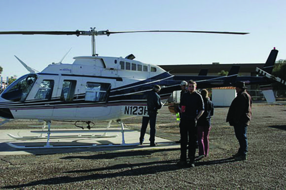 The Crew loading into the helicopter in search of Arizona treasures