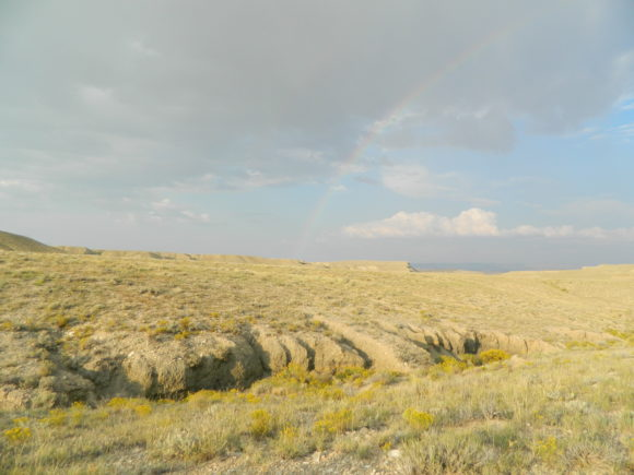 A rainbow in the sky, overlooking the diggings for Calcite included Septarian nodules in Utah